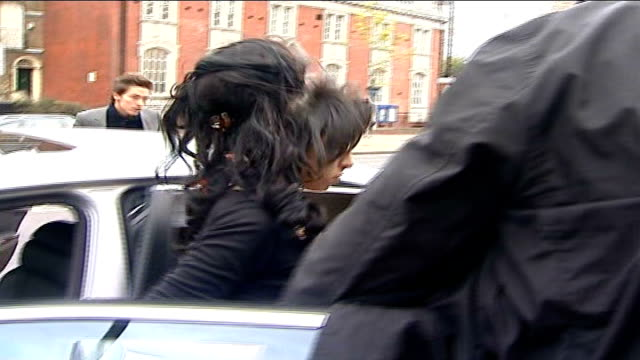 Amy Winehouse at court to support her husband ENGLAND London Thames Magistrates Court EXT Amy Winehouse out of car and along to court accompanied by...