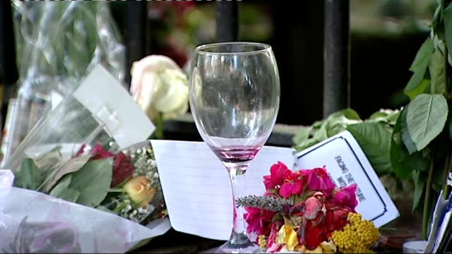 tribute flowers; england: london: camden square: ext various of tribute flowers and other items left outside amy winehouse's home, including beer... - amy winehouse stock-videos und b-roll-filmmaterial