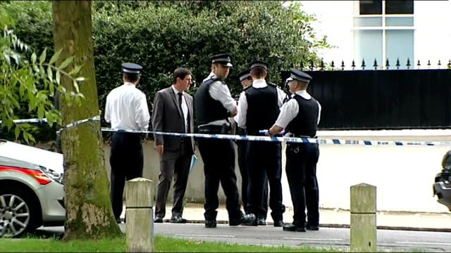 amy winehouse found dead at her home london camden ext police outside flat of amy winehouse bv forensics officers entering flat mourner laying candle... - mourner stock videos and b-roll footage