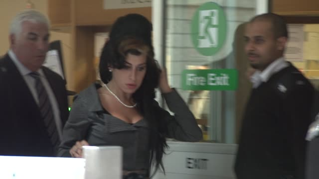 Amy Winehouse leaves at the Amy Winehouse Attends Court on Charges of Assault at London England