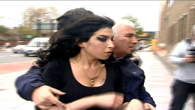 Amy Winehouse supports husband during court appearance London Amy Winehouse and her father Mitch into Thames Magistrates Court for previous court...