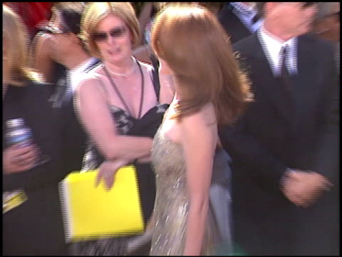 vídeos de stock, filmes e b-roll de amy yasbeck at the 2004 emmy awards arrival at the shrine auditorium in los angeles california on september 19 2004 - amy yasbeck