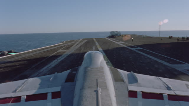 an a-6 intruder lands on an aircraft carrier on the ocean. - aircraft carrier stock videos & royalty-free footage