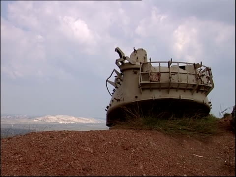 an abandoned military tank occupies a dirt field in golan heights. - armoured vehicle stock videos and b-roll footage