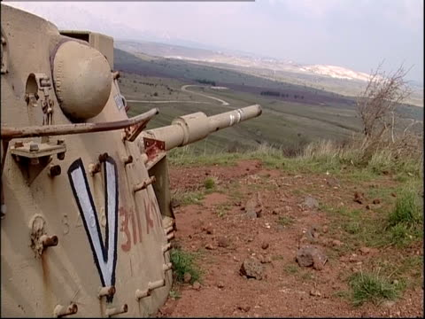 An abandoned military tank occupies a former battlefield in Golan Heights.