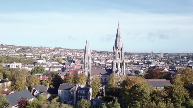 an abstract aerial shot of a cathedral in cork, ireland - town stock videos & royalty-free footage