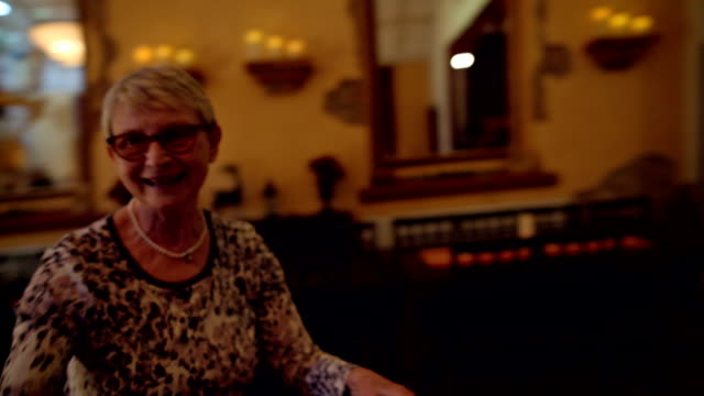 vidéos et rushes de an active female senior is dancing during a birthday party - jeune d'esprit