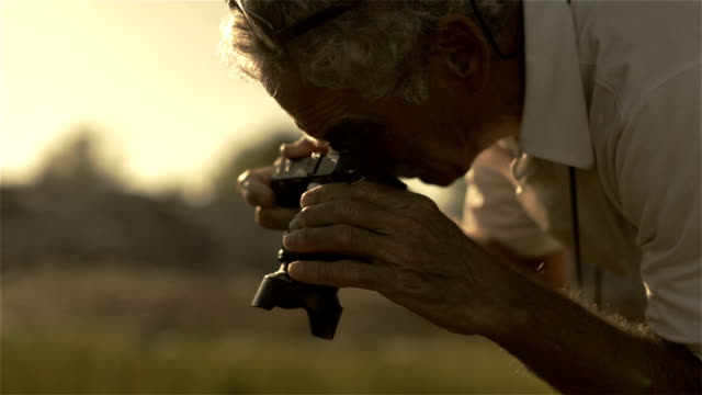 An active retiree photographs in the first dawn