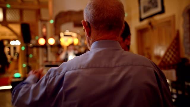 stockvideo's en b-roll-footage met an active senior is dancing during a birthday party - jong van hart