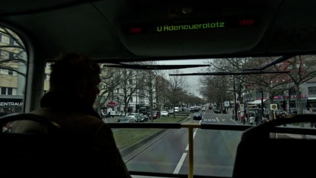 an active senior man drives in a double-decker bus across the kurf��rstendamm in berlin - nordeuropäischer abstammung stock-videos und b-roll-filmmaterial