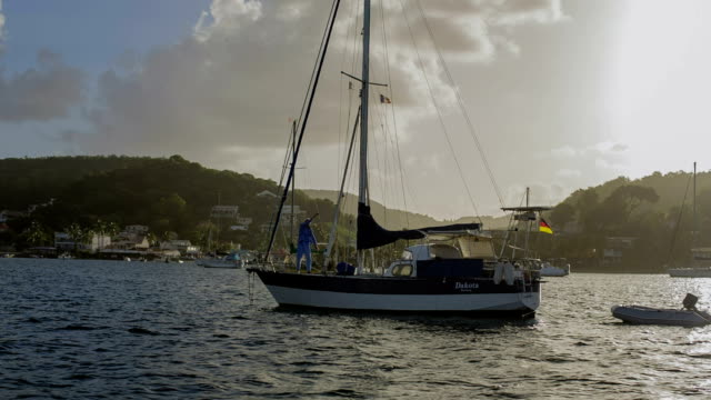An active very old sailor on circumnavigation during early morning exercise on his old sailboat