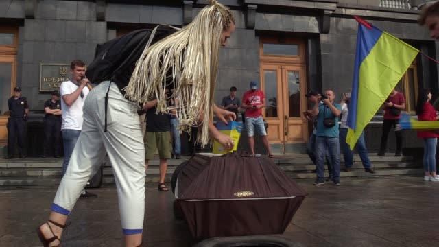 An activist sets up the Ukrainian Constitution on a coffin during a symbolic funeral of the Ukrainian Constitution outside the Presidential office in...