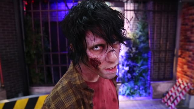 stockvideo's en b-roll-footage met an actor dressed as a zombie from capcom co.'s biohazard re: 2 video game, known as resident evil 2 outside japan, poses during the tokyo game show... - television game show
