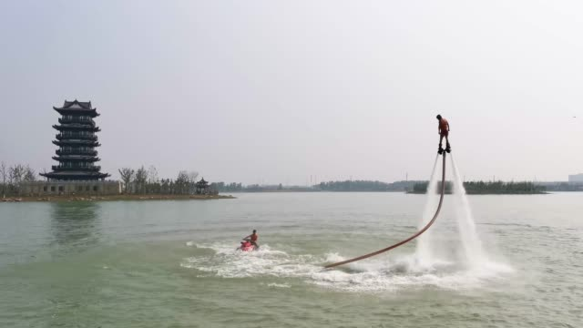 an actor performs wakeskate at qianlonghu scenic spot on may 1, 2020 in huaibei, anhui province of china. - stunt stock videos & royalty-free footage