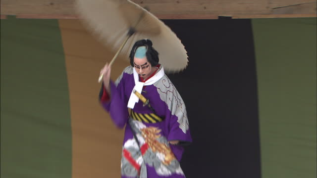 an actor strolls onto a kabuki stage with an umbrella. - actor stock videos & royalty-free footage