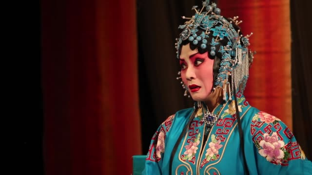 An actress performs in a traditional Qinqiang Opera production.
