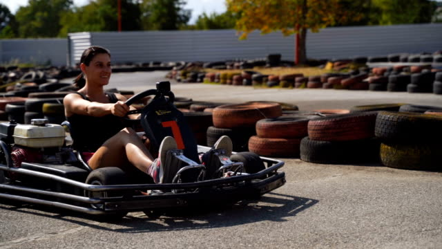 an adrenaline rush -mature woman on go-cart race - go cart stock videos & royalty-free footage