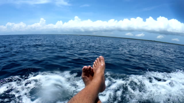 pov of an adult carefree man riding on a boat - passenger craft stock videos & royalty-free footage