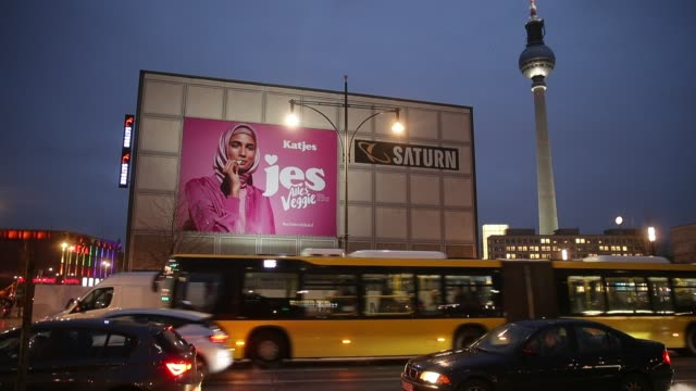 An advertisement for a new line of vegetarian sweets by German candymaker Katjes features a Muslim woman wearing a headscarf at Alexanderplatz on...