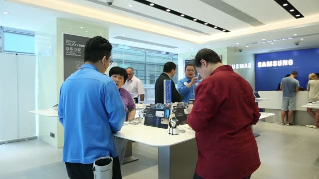 stockvideo's en b-roll-footage met an advertisement for the samsung electronics co galaxy s5 smartphone stands inside a samsung retail store in the central district of hong kong a... - hongkong eiland