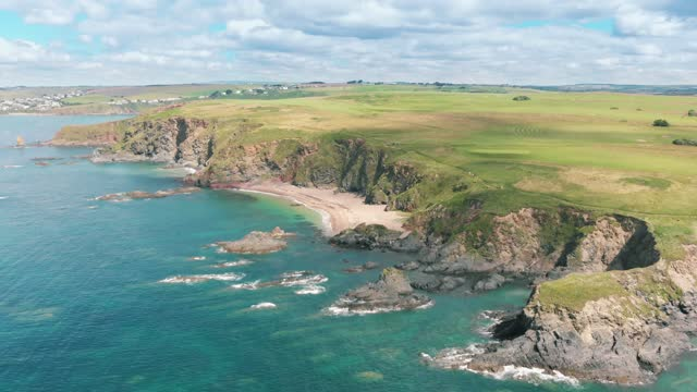 an aerial drone shot of a beautiful unspoilt sandy beach at thurlestone on july 15, 2021 in devon, england. - coastal feature stock videos & royalty-free footage
