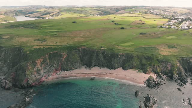 an aerial drone shot of a beautiful unspoilt sandy beach at thurlestone on july 15, 2021 in devon, england. - beauty in nature stock videos & royalty-free footage