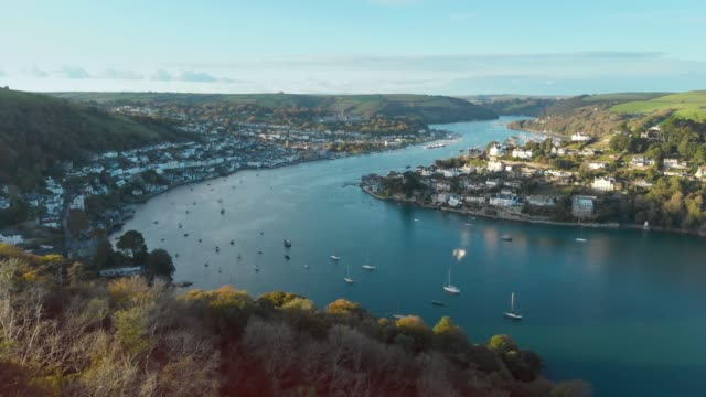 an aerial drone shot of boats in the river dart running through the town of dartmouth in devon, england. - idyllic stock videos & royalty-free footage
