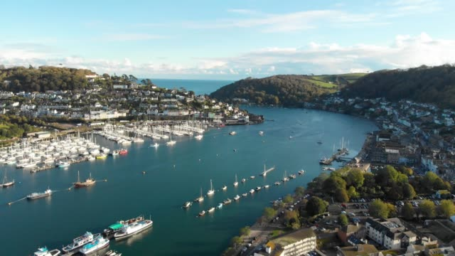 an aerial drone shot of boats in the river dart running through the town of dartmouth in devon, england. - silence stock videos & royalty-free footage