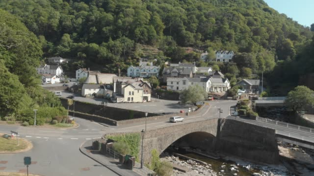 an aerial drone shot of the village of lynmouth in exmoor national park, devon, united kingdom. - exmoor national park stock videos & royalty-free footage