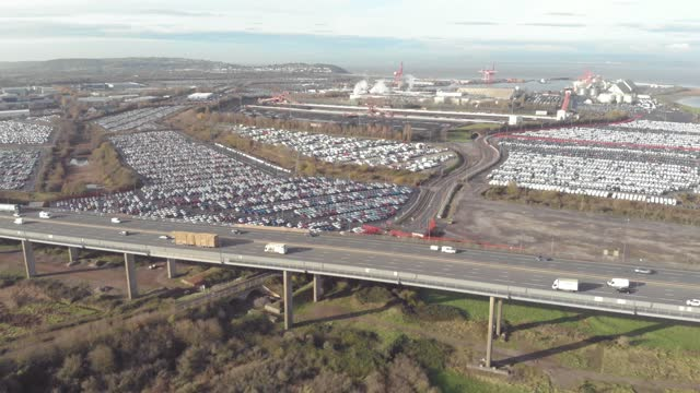 an aerial drone shot of traffic driving on the m5 motorway overpass over an industrial landscape on october 12 2020, in avonmouth, uk. - road junction stock videos & royalty-free footage