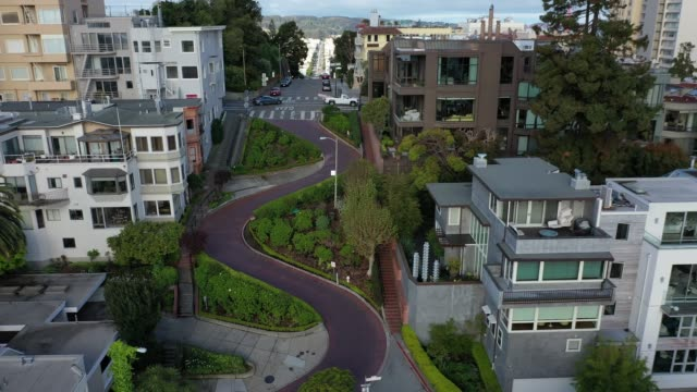 an aerial drone view of an empty lombard street a tourist destination empty during the coronavirus pandemic on march 30 2020 in san francisco... - san francisco california stock videos & royalty-free footage