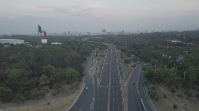 an aerial drone view of anillo periférico avenue of during the coronavirus pandemic on march 31 2020 in mexico city mexico after being criticized for... - mexico stock videos & royalty-free footage