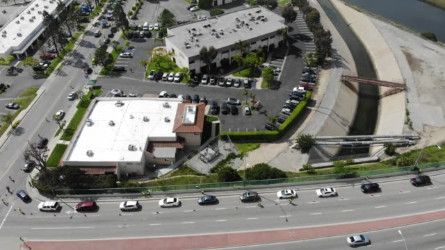 an aerial drone view of cars lined up to receive food distributed by the los angeles regional food bank amidst the coronavirus pandemic on april 18... - cars in a row stock videos & royalty-free footage