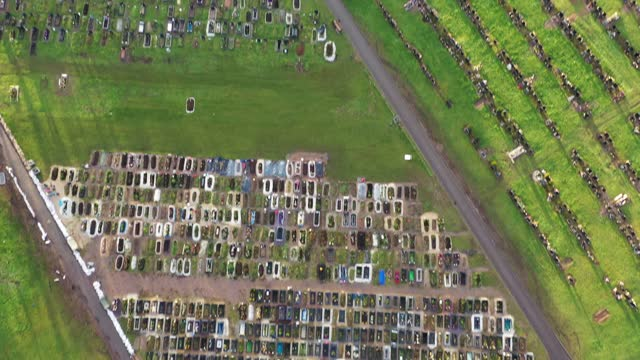 an aerial drone view of recent burial chambers at handsworth cemetery where the section dedicated to the muslim community has been used up faster... - handsworth stock videos & royalty-free footage