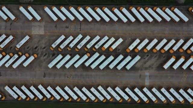 an aerial drone view of school buses parked at fort worth independent school district transportation headquarters on march 31, 2020 in fort worth,... - stationary stock-videos und b-roll-filmmaterial