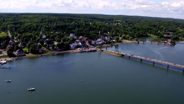 an aerial flyover of wiscasset maine - dronebase stock videos and b-roll footage