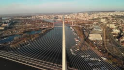 An aerial hyper-lapse view of the famous Ada bridge in Belgrade, Serbia at winter