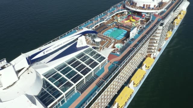 an aerial image of royal caribbean international cruise ship, ovation of the seas sitting empty of passengers in sydney harbour on march 21, 2020 in... - cruise ship stock videos & royalty-free footage