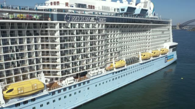 an aerial image of royal caribbean international cruise ship, ovation of the seas sitting empty of passengers in sydney harbour on march 21, 2020 in... - cruise vacation stock videos & royalty-free footage