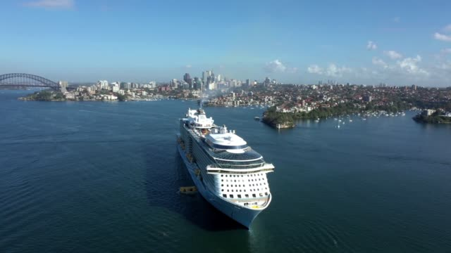an aerial image of royal caribbean international cruise ship, ovation of the seas sitting empty of passengers in sydney harbour on march 21, 2020 in... - cruising stock videos & royalty-free footage