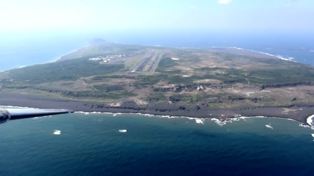 an aerial observation february 10 shows iwojima island—a fierce battleground during world war ii—as it appears at present although paths can be seen... - iwo jima island stock videos & royalty-free footage