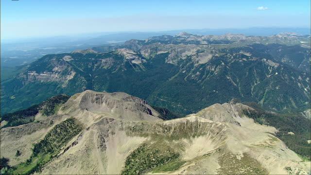 vidéos et rushes de an aerial of a barren mountain range reflects beauty in isolation. - mountain range