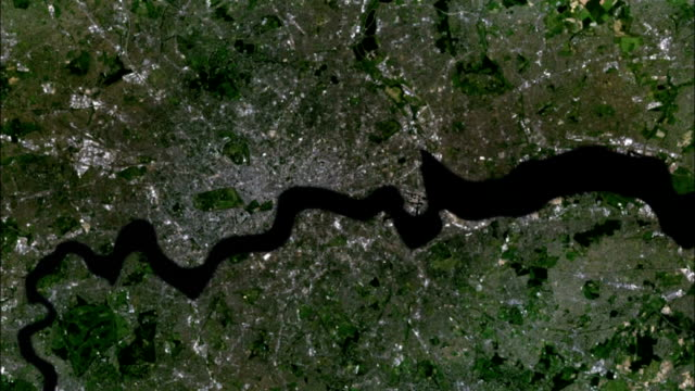 an aerial of london demonstrates the impact of rising sea levels. available in hd. - översvämning bildbanksvideor och videomaterial från bakom kulisserna