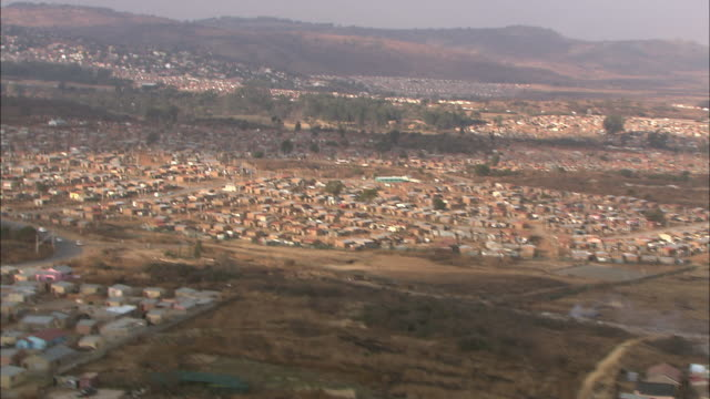 an aerial over soweto, south africa, reveals hundreds of homes. - soweto stock videos and b-roll footage