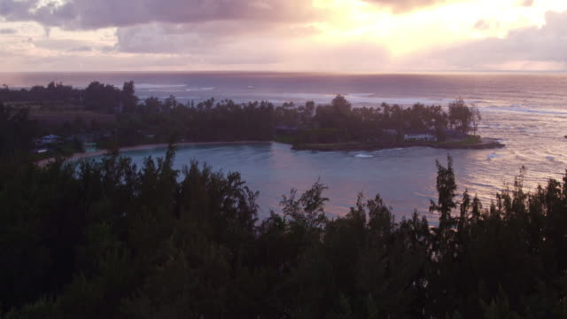 an aerial reveal to show a bay during sunset - kahuku stock videos & royalty-free footage
