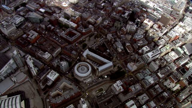 an aerial shot above the city centre of manchester. available in hd. - manchester england stock videos & royalty-free footage