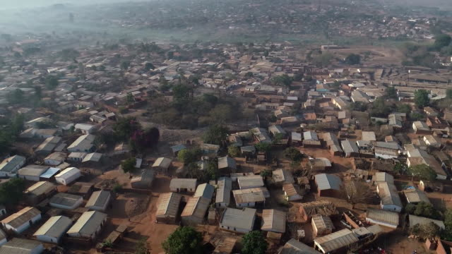 an aerial shot from a drone flying over a town in malawi africa on october 3 2018 - aerial or drone pov or scenics or nature or cityscape stock videos & royalty-free footage