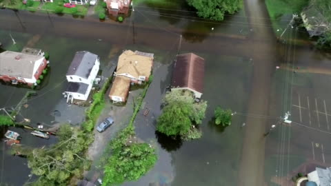 an aerial shot from a drone showing flooding in the aftermath of hurricane florence on september 15, 2018 in new bern, north carolina. - environment or natural disaster or climate change or earthquake or hurricane or extreme weather or oil spill or volcano or tornado or flooding stock videos & royalty-free footage