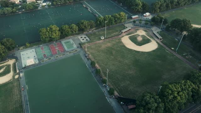 an aerial shot of an empty baseball field in brooklyn, new york city - brooklyn new york stock videos & royalty-free footage