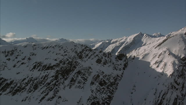 an aerial shot of new zealand's rugged mountain peaks. - winter stock videos & royalty-free footage